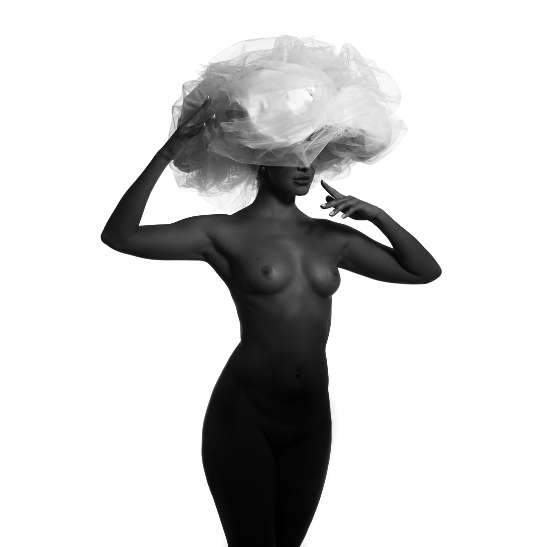 Black model and big white hat.