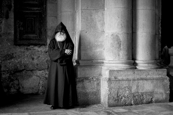 A Priest Waits . . .